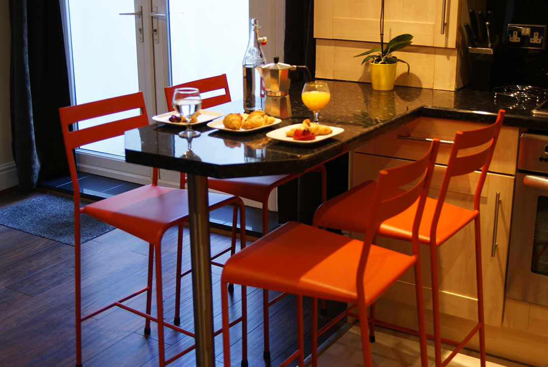 breakfast bar with seating for four people